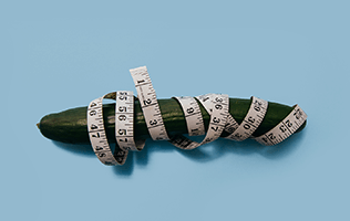 cucumber wrapped in tape measure