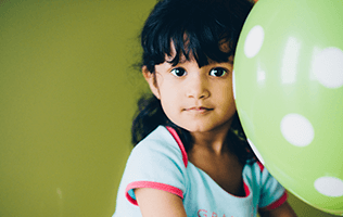 young girl with green balloon