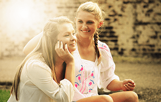2 young women smiling