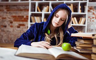 young woman reading a book with green apple